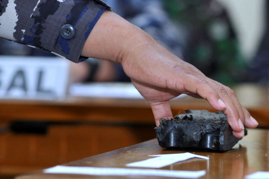 Debris believed to be from the missing Indonesian submarine is during a media conference in Bali on April 24, 2021.