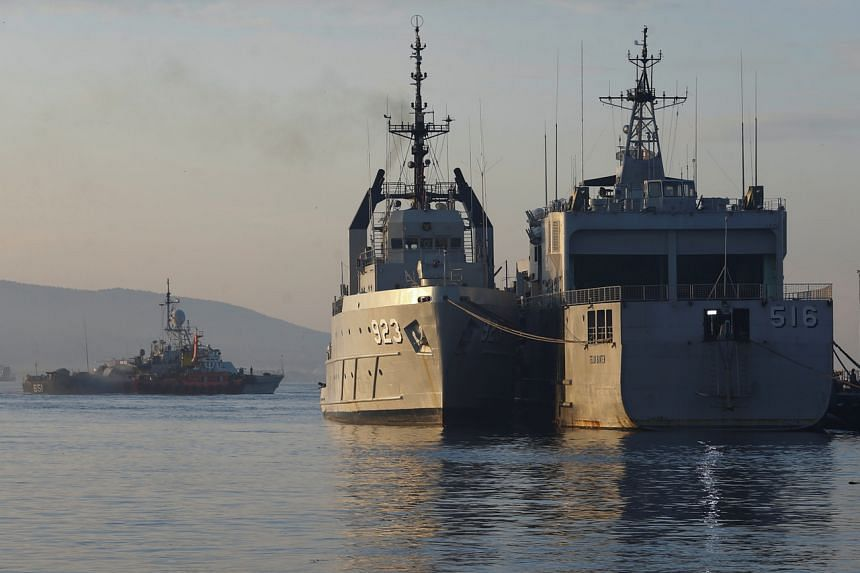 Indonesian Navy ships are seen at the Tanjung Wangi port as the search continues for a missing submarine in Indonesia's East Java Province on April 25, 2021.