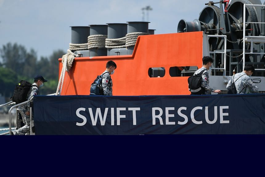 Republic of Singapore Navy personnel boarding the MV Swift Rescue on April 21, 2021.