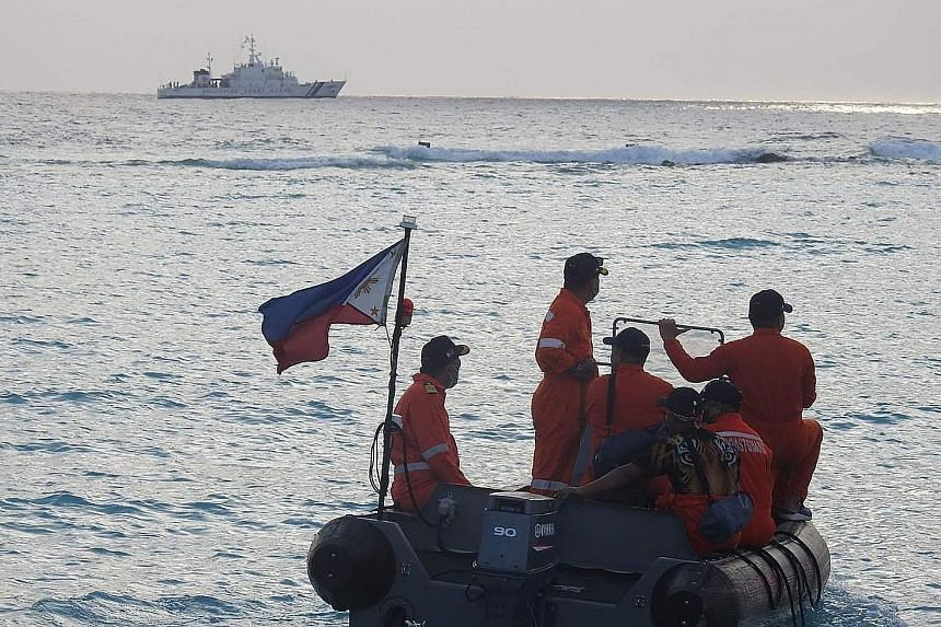 An undated photo from the Philippine coast guard showing its personnel on a maritime exercise near Thitu Island in the disputed South China Sea. PHOTO: AGENCE FRANCE-PRESSE