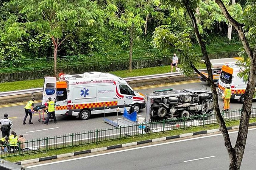 The driver and nine passengers in Saturday morning's lorry accident near The Rail Mall in Upper Bukit Timah Road, understood to be foreign workers, were aged between 26 and 50. PHOTO: LIANHE ZAOBAO