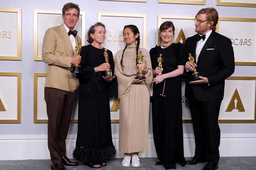 Producers Peter Spears, Frances McDormand, Chloe Zhao, Mollye Asher and Dan Janvey, winners of the award for best picture for Nomadland.