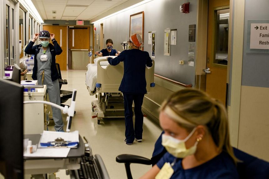 Medical staff move a hospital bed out of the intensive care unit at Beaumont Hospital in Royal Oak, Michigan on April 22, 2021.