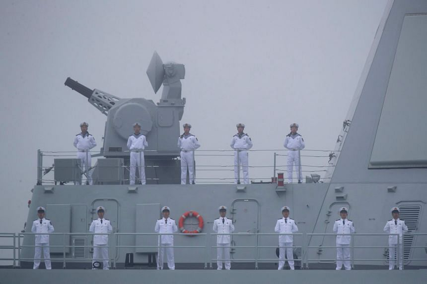 In a photo taken on April 23, 2019, Chinese sailors stand on the deck of the new type 055 guide missile destroyer Nanchang of the Chinese People's Liberation Army Navy.
