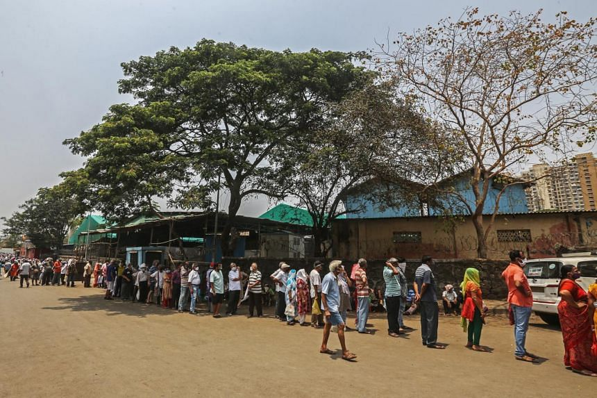 People waiting in queue to receive a shot of the Covid-19 vaccine in Mumbai, India, on April 26, 2021.