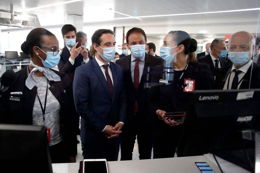 French Transport Minister Jean-Baptiste Djebbari (in front, second from left) visiting the Paris-Orly Airport on April 27, 2021.