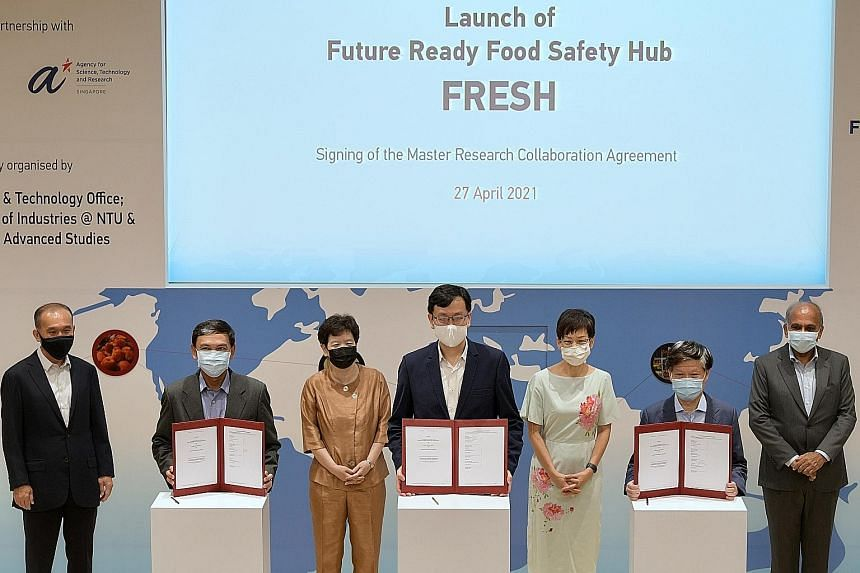 Minister for Sustainability and the Environment Grace Fu (third from right) at the launch of the Future Ready Food Safety Hub yesterday, with (from left) Singapore Food Agency (SFA) chairman Lim Chuan Poh, SFA chief executive Lim Kok Thai, A*Star cha