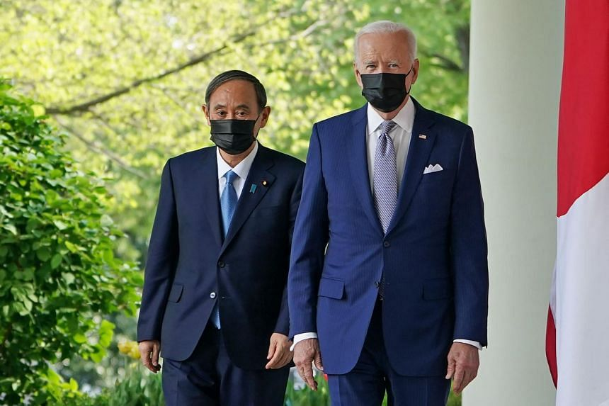 Japan's Prime Minister Yoshihide Suga (left) and US President Joe Biden walk to a press conference in the Rose Garden of the White House, on April 16, 2021.
