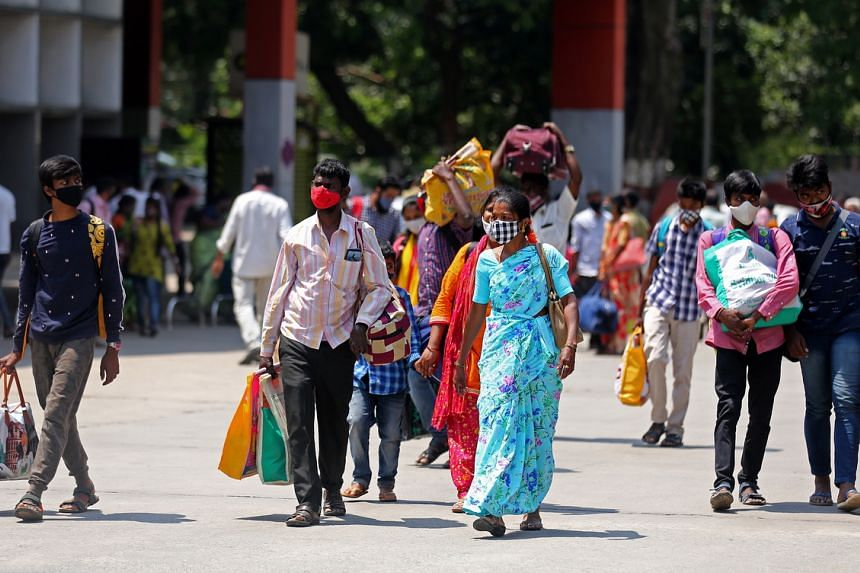 Indian migrant workers going back to their home town at the city railway station in Bangalore, on April 26, 2021.
