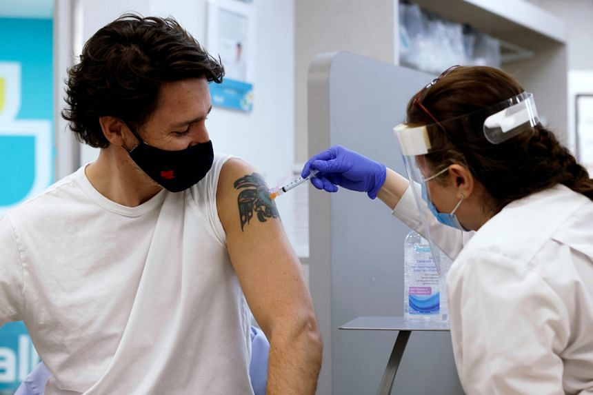 Canada's Prime Minister Justin Trudeau is inoculated with AstraZeneca's vaccine at a pharmacy in Ottawa, on April 23, 2021.