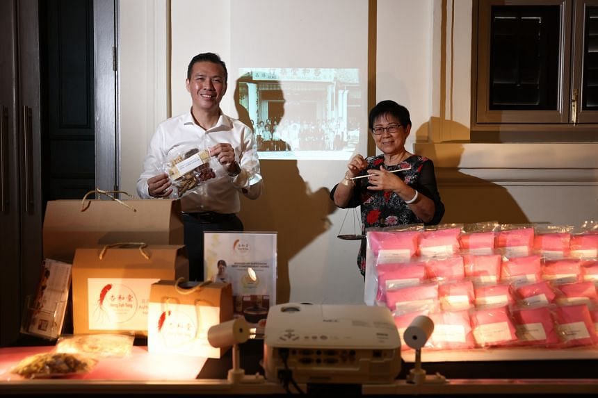 Mr Lee Chin Siong's (left) clinic is one of the participants of this year's Singapore HeritageFest.
