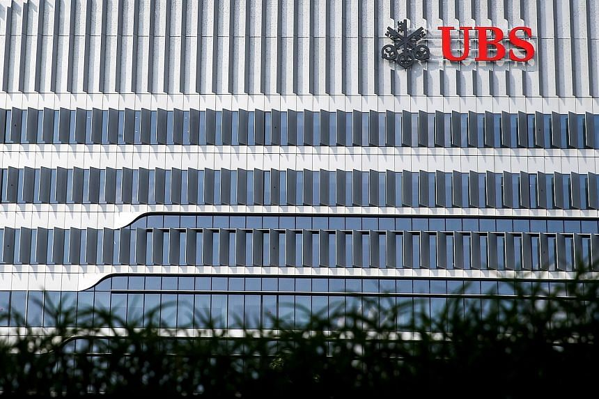 Swiss bank UBS has moved into its new office (above) at 9 Penang Road that hosts its first global cyber-fusion centre (left), and accommodates the bank's 3,000 or so staff across 400,000 sq ft (top).