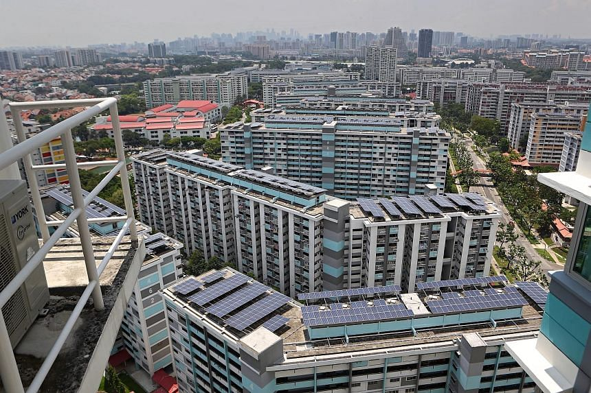 Solar panels on top of HDB blocks. The conference will discuss ways to navigate the challenges and opportunities brought by the energy transition. PHOTO: LIANHE ZAOBAO