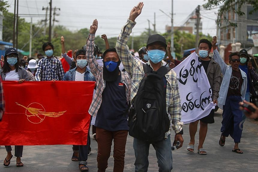 Demonstrators flashing the three-finger salute during an anti-military coup protest in Mandalay, Myanmar, yesterday. Pro-democracy protests have taken place in cities and towns across the country since the Feb 1 military coup. PHOTO: EPA-EFE