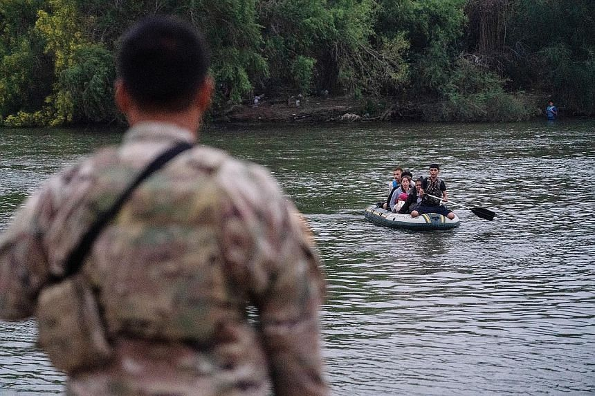 Above: A Covid-19 vaccination site in Mississippi on Tuesday. In a recent poll, people were more optimistic about defeating Covid-19 than they were in January. Right: Asylum seekers crossing the Rio Grande river into the US from Mexico on Tuesday. Pr