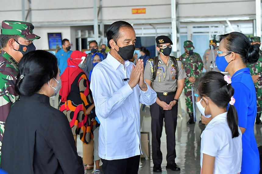 Indonesian President Joko Widodo speaking with the families of the submarine crew members who died on board the KRI Nanggala 402, in Surabaya on April 29, 2021.