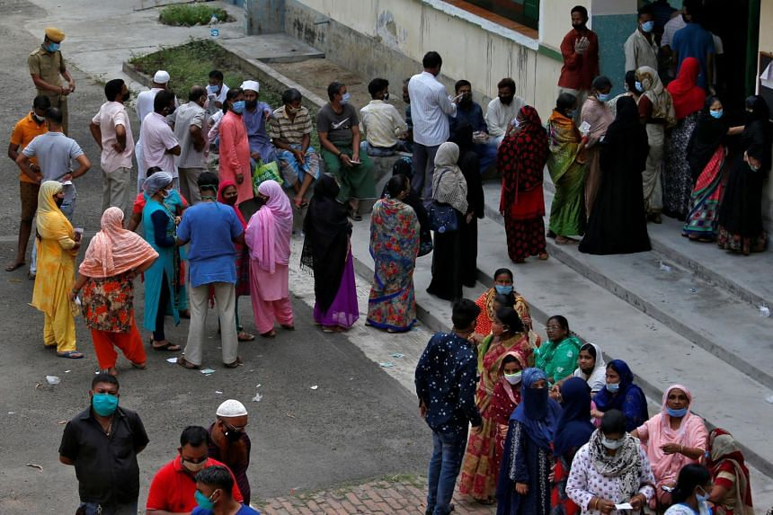 People queueing to cast their votes at a polling station in Kolkata, on April 29, 2021.
