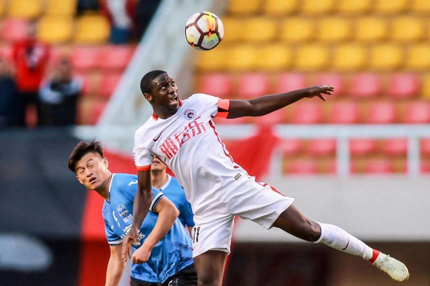 Jacob Mulenga (right) is not the only player trying to claw back unpaid wages from Chinese football clubs that have gone bust.