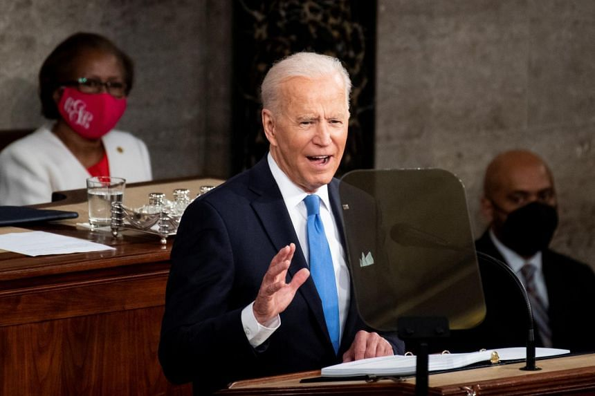 US President Joe Biden addresses to a joint session of Congress at the US Capitol in Washington, on April 28, 2021.