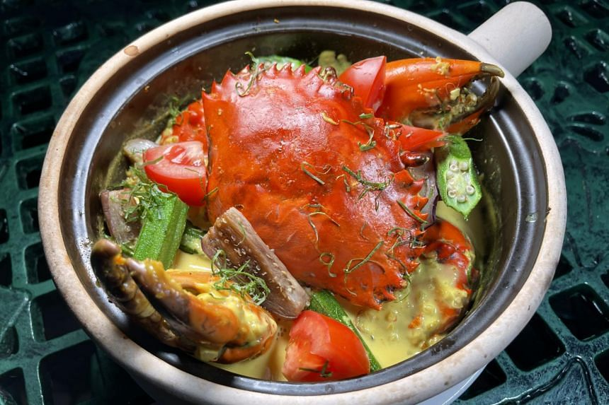Live Sri Lankan whole crab cooked in the style of Masak Lemak Chilli Api featured at Ah Hoi's Kitchen.