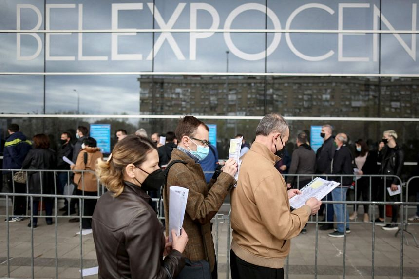 Bosnian citizens queue to receive a dose of the AstraZeneca Covid-19 vaccine at one of Belgrade's vaccination centres, in March 2021.