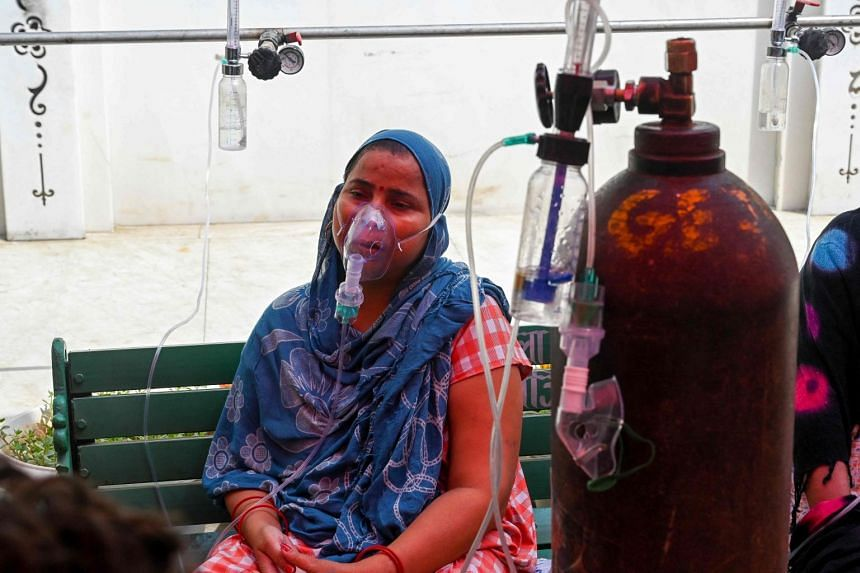 A Covid-19 patient breathes with the help of oxygen in Ghaziabad, India, on April 28, 2021.