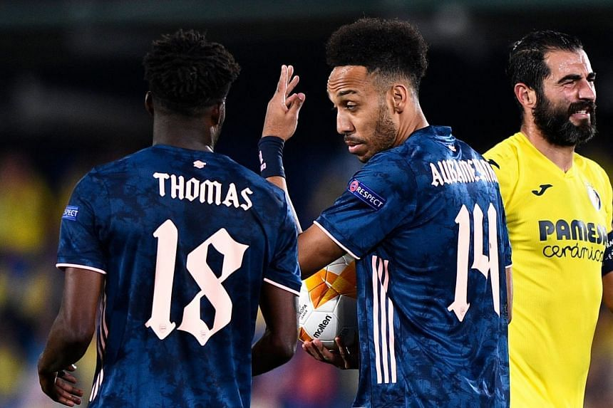 Arsenal's Thomas Partey talks to Pierre Aubameyang during the match.