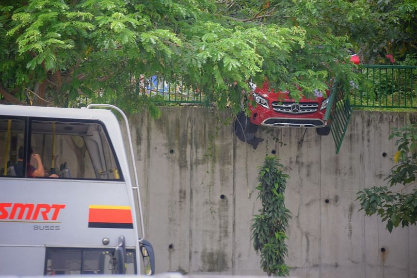 The woman had lost control of her red Mercedes while visiting a nursery in Clementi and crashed through a barrier.
