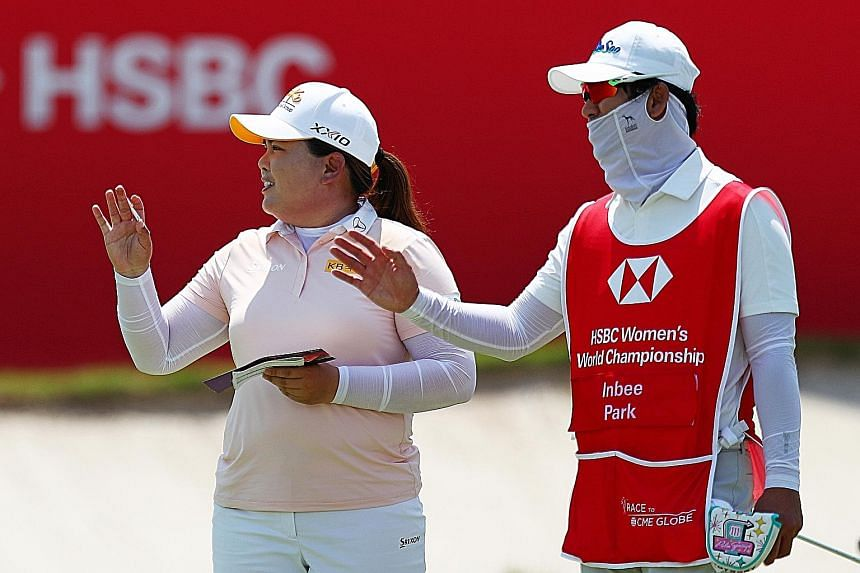 """South Korean star Park In-bee, the Rio Olympic champion, with her husband and caddie Nam Gi-hyeob after taking a one-shot first-round lead in the HSBC Women's World Championship. She gave herself a nine but Nam a perfect 10 for carrying her bag in """"v"""