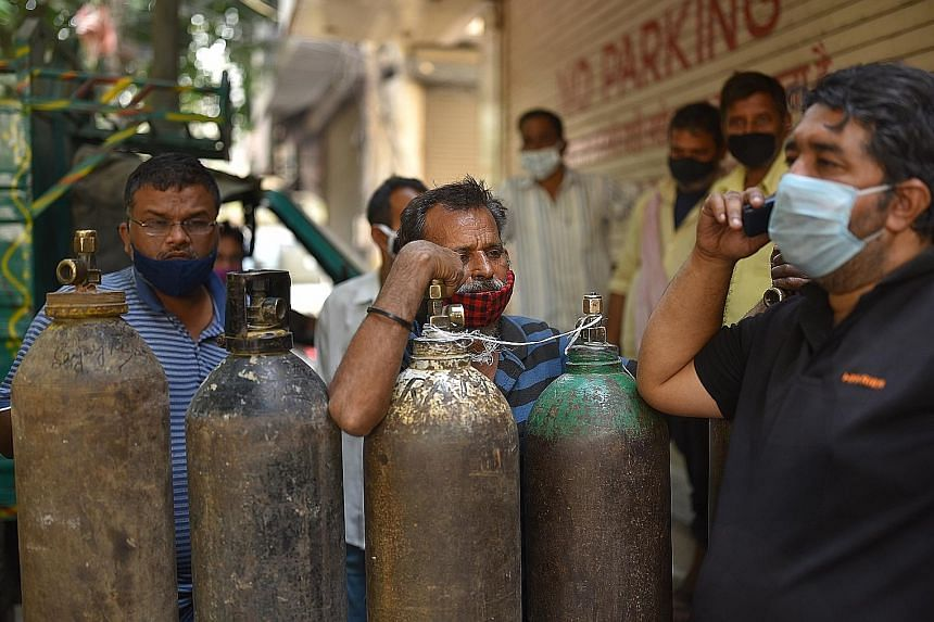 Indians waiting to fill their oxygen cylinders at an oxygen vendor in New Delhi yesterday. International support has become crucial for India as people in its cities are in desperate need of oxygen and medicines. The Indian authorities said nations i