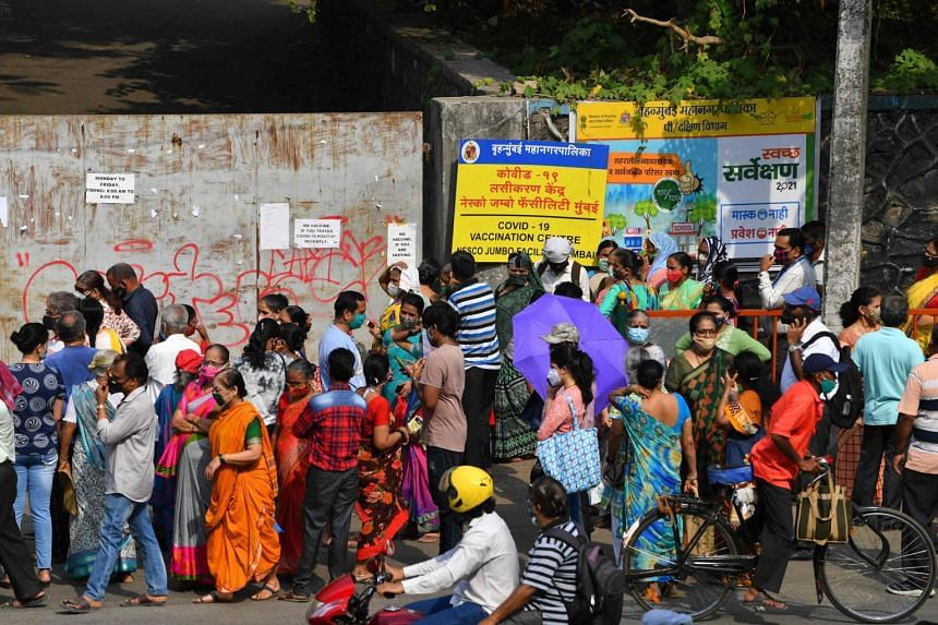 People gathering outside the entrance of a Covid-19 vaccination centre in Mumbai on April 28, 2021.