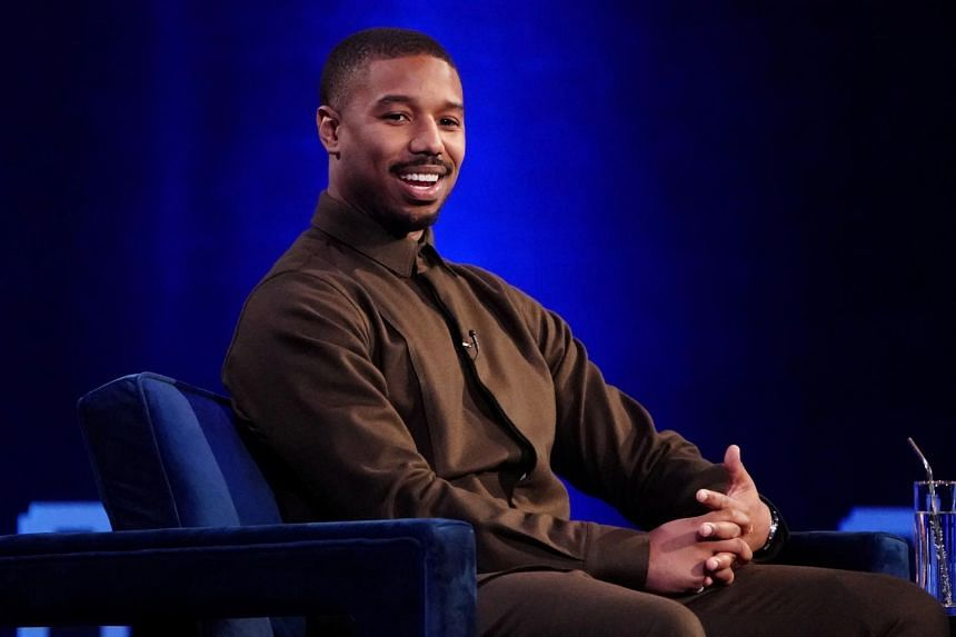 In this photo taken on Feb 5, 2019, Michael B. Jordan speaks with Oprah Winfrey on stage during a taping of her TV show.