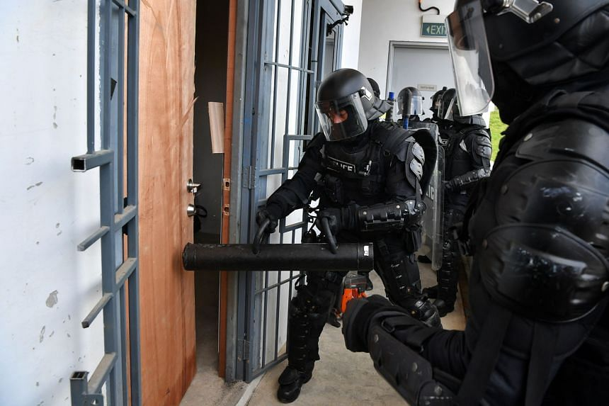 Special Operations Command officers breaching a door during a demonstration at the Home Team Tactical Centre on Tuesday.
