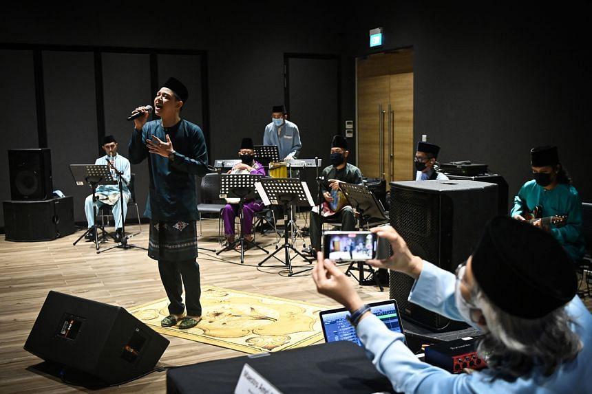 Mr Hady Mirza and the Singapore Malay Orchestra performing Ramadan Yang Mulia, Syawal Yang Indah at Wisma Geylang Serai yesterday. The song, the first of four new ones, was inspired by the Malay/Muslim community celebrating Ramadan and Hari Raya Aidi
