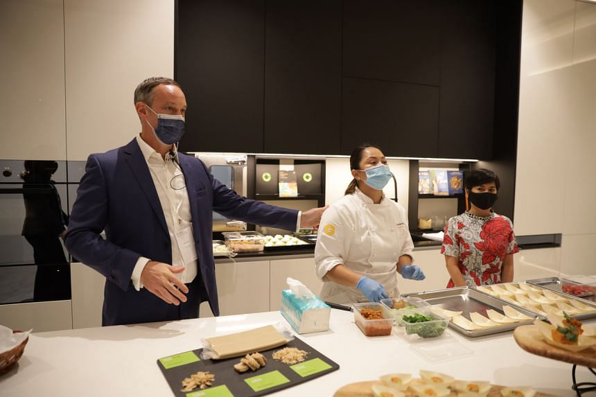 Givaudan Taste & Wellbeing's head of regional innovation Alex Ward (left) showcasing plant-based protein recipes developed and cooked in-house on April 26, 2021.