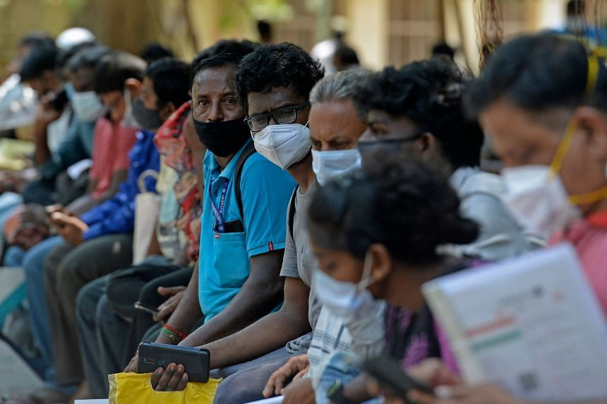People queue outside a government dispensary to buy Remdesivir, an antiviral drug, in Chennai, on April 30, 2021.