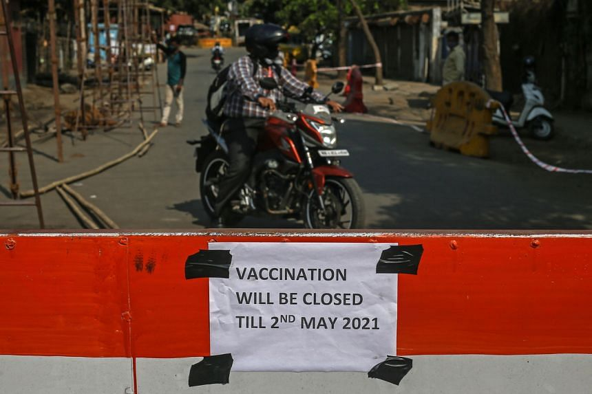 A notice about the shortage of Covid-19 vaccines is seen outside a vaccination centre in Mumbai, on April 30, 2021.