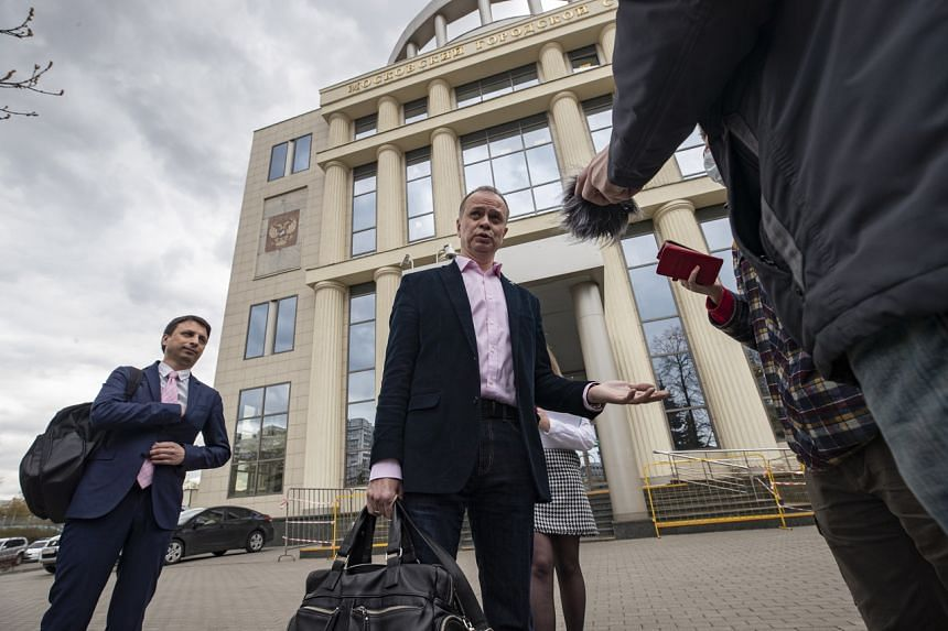 Mr Ivan Pavlov (centre) speaks to media outside the Moscow City Court, on April 29, 2021.