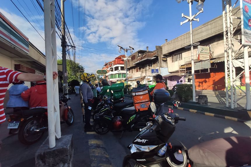 Food delivery riders in Manila perform a task that is arguably as important as that rendered by hospital staff, given that they help feed people who have to work from home because of Covid-19 restrictions.