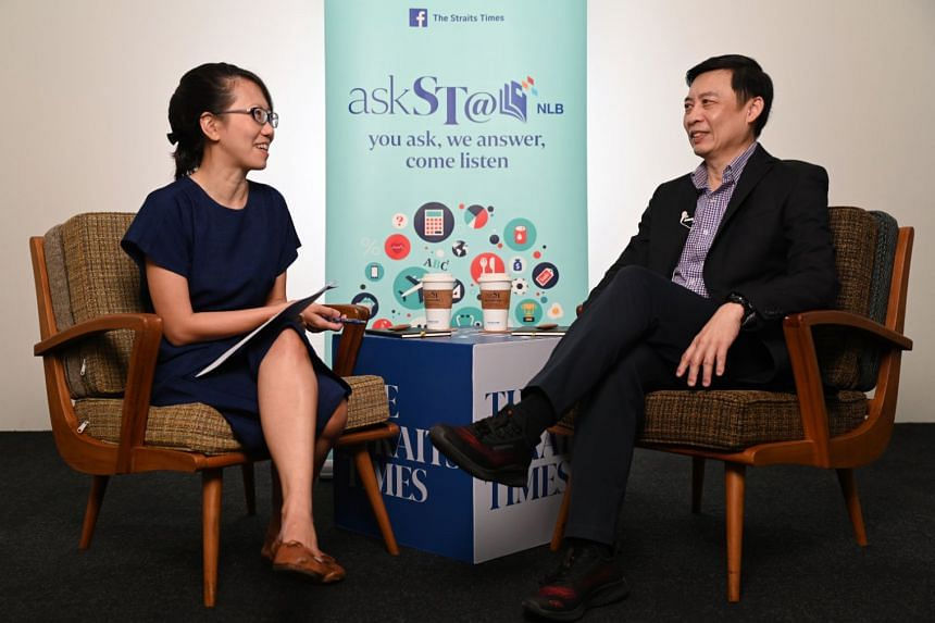 ST tech editor Irene Tham (left) and Mr Jeffrey Goh, head of Grablink, a regional payment company of Grab Financial Group.