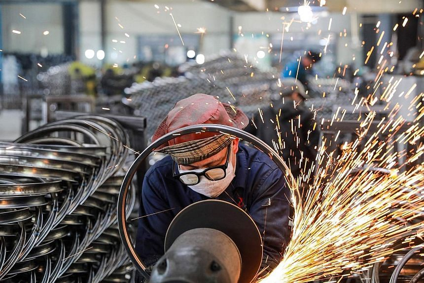 A factory worker in Hangzhou, in China's eastern Zhejiang province. China's economic recovery quickened sharply in the first quarter of the year with record growth of 18.3 per cent, shaking off the hit from last year's slump induced by the Covid-19 p