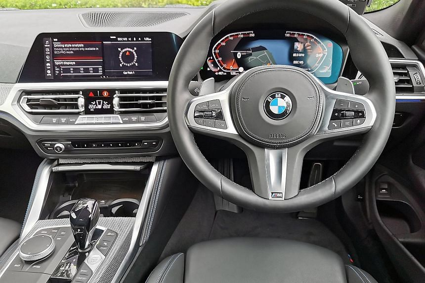 Both the Audi A5 (top left) and BMW 420i (left) have a 12.3-inch digital instrument cluster behind the steering wheel. The A5 presents the information more legibly than the 420i's over-stylised graphics. The BMW 420i Coupe (right) has dramatic looks