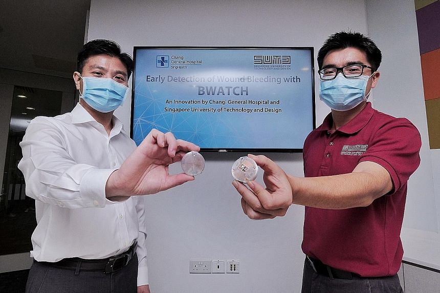 Changi General Hospital's Associate Professor Chionh Chang Yin (far left) and Singapore University of Technology and Design's Associate Professor Foong Shaohui with the BWATCH sensor. The wireless, lightweight device is placed over a patient's bandag