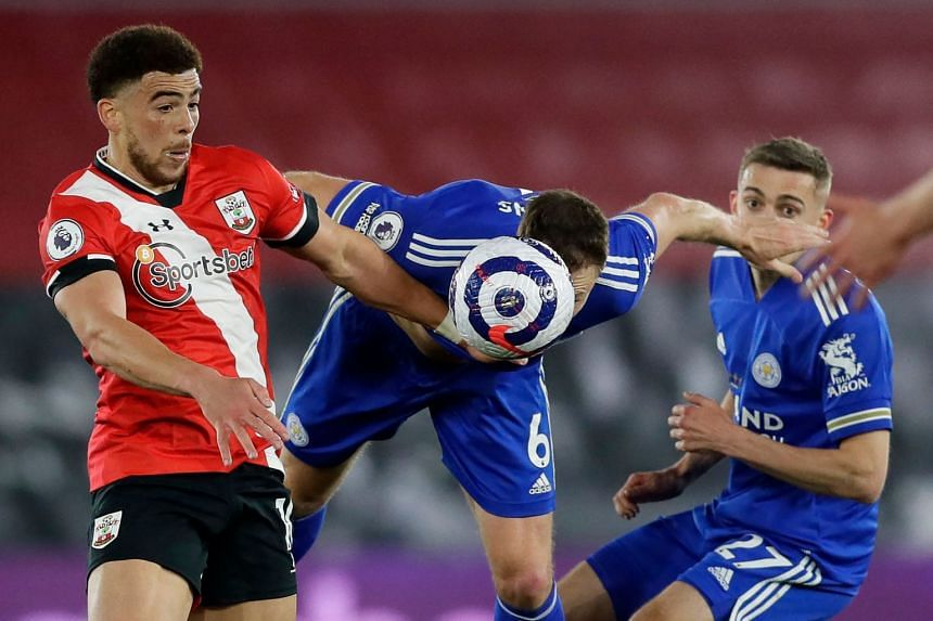 Leicester City's Jonny Evans (centre) vies with Southampton's Che Adams (left) during the match.