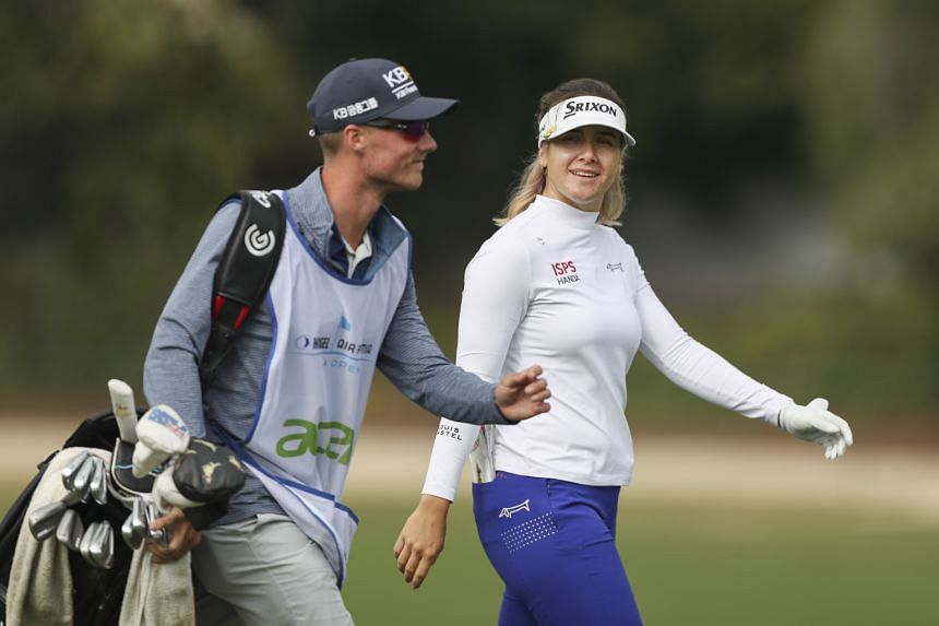 Hannah Green walks with her caddie down the 13th fairway at the LA Open on April 23, 2021.