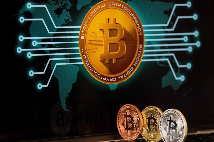 A visual representation of the digital cryptocurrency bitcoin at the Bitcoin Change shop in the Israeli city of Tel Aviv. As the coronavirus pandemic has caused a surge in online payments, some central banks are mulling over virtual currencies to riv