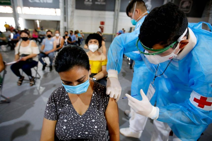 A teacher receives a Covid-19 vaccine at a vaccination centre in Guadalajara, Mexico, on April 28, 2021.