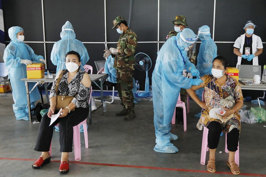 People getting vaccinated at a centre in Phnom Penh, Cambodia, on May 1, 2021.