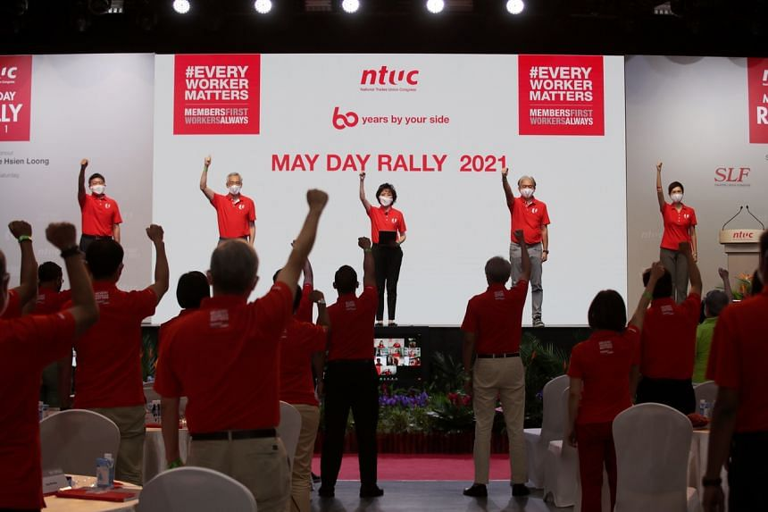"""PM Lee (second from left) noted that the labour movement had """"protected workers in every way""""."""