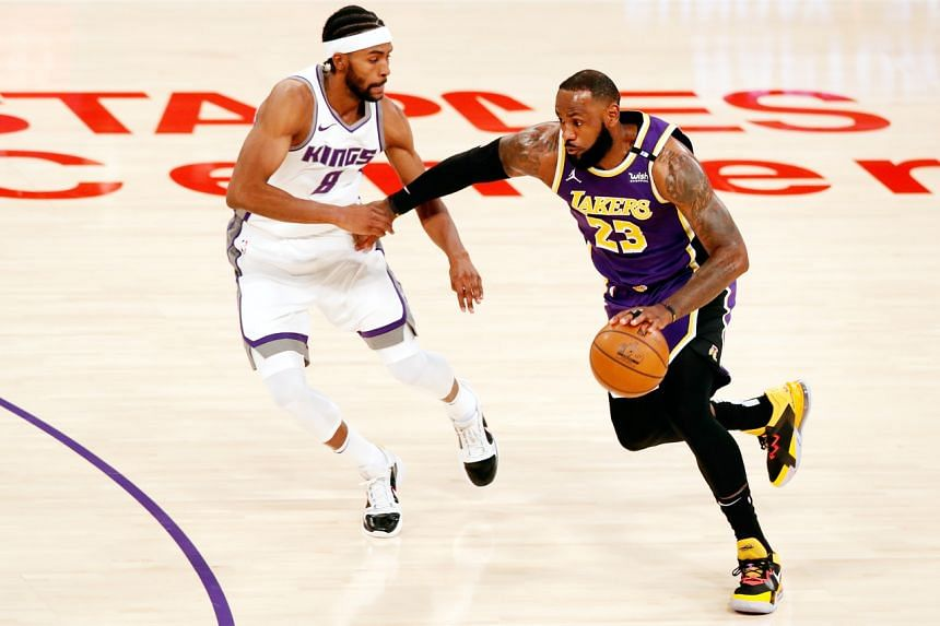 Los Angeles Lakers forward LeBron James (right) in action against Sacramento Kings forward-guard Maurice Harkless, on April 30, 2021.